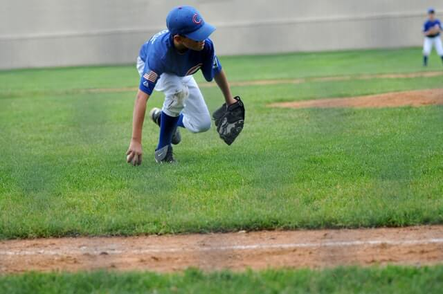 a young boy focused while playing baseball