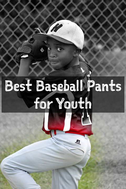 a boy wearing red shirt and white baseball pants with a cap on its head. he is using baseball gloves and is supposedly holding a ball.