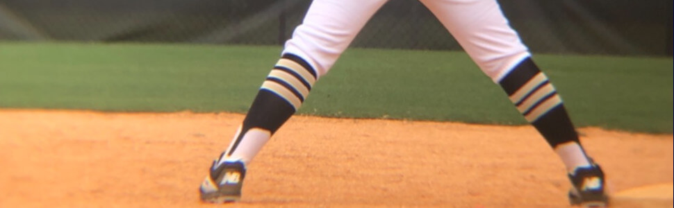close up view of a player wearing a baseball sitrrup
