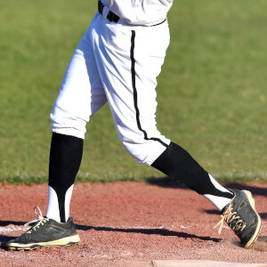 player what look likes swinging a bat is wearing a baseball stirrup